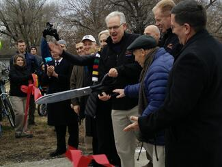 Governor Nixon cuts the ribbon to open Rock Island Trail State Park
