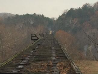 Ties on the Gasconade River Bridge burned in a fire that started overnight