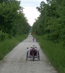 A rider enjoys a recumbent tricycle on the Katy Trail