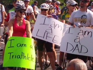Cyclists rally in support of cyclist Randy Murdick, who was struck by Sunset Hil