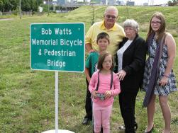 Bob's wife Jean and family members unveil the new signs naming the bike/ped path