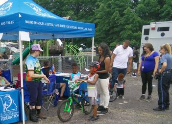 Giving bikes away at the Healthy Living KC Fair